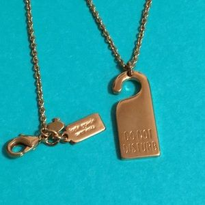 kate spade Do Not Disturb sign charm and necklace